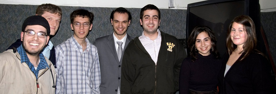 From left to right: Toviah Moldwin, Yoni Teitz, Eli Putterman, Yitzchok Pinkesz, Tzvi Goldfeder, Ita Goldfeder, Chaya Huber